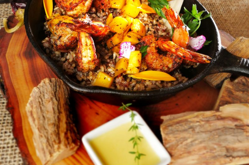 BBQ Spiced Shrimp with Champagne® Mango Sunset Butter, Native Wild Rice & Campfire Tomatoes Chicken